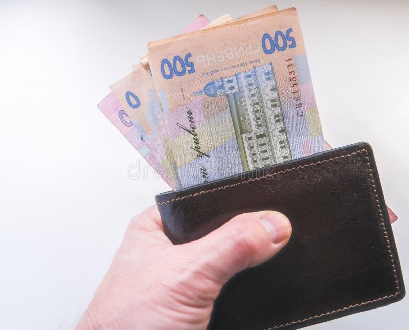 乌克兰hryvnia金钱在小包在 库存照片