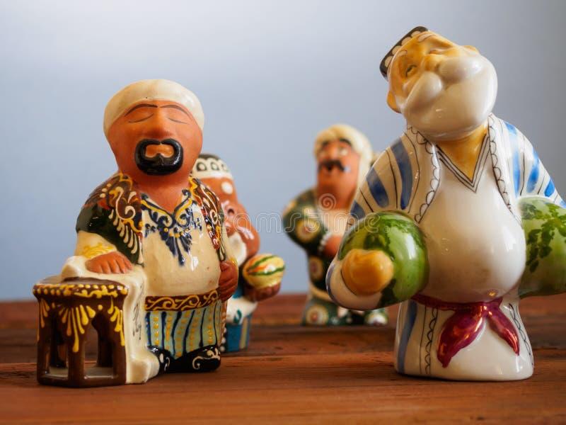 乌兹别克人陶瓷小雕象-全国纪念品 免版税库存图片