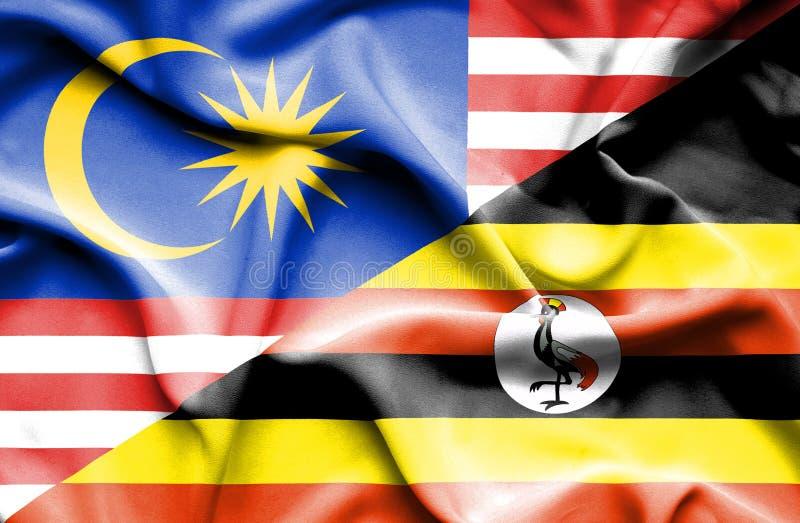 乌干达和马来西亚的挥动的旗子 皇族释放例证
