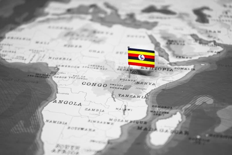 乌干达的旗子世界地图的 库存图片