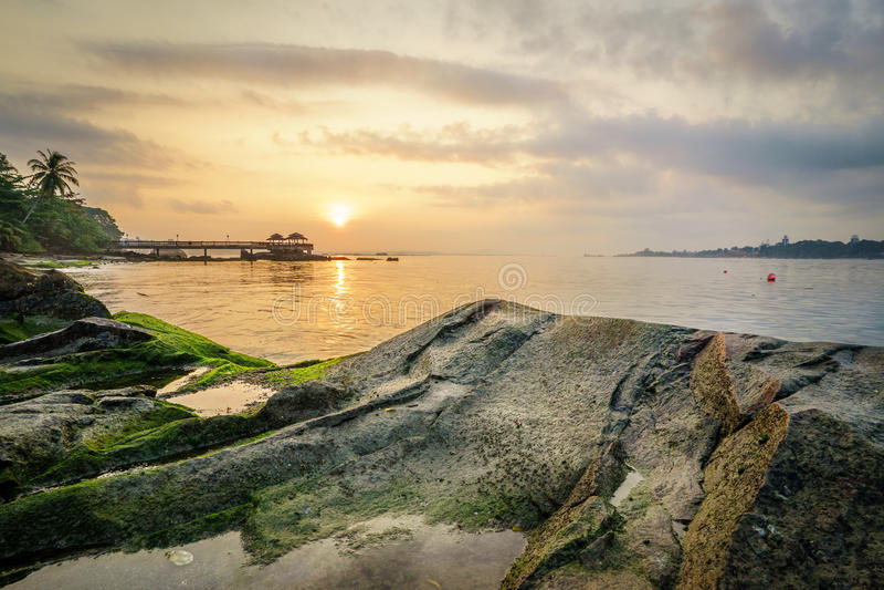 乌敏岛,新加坡日落  库存照片