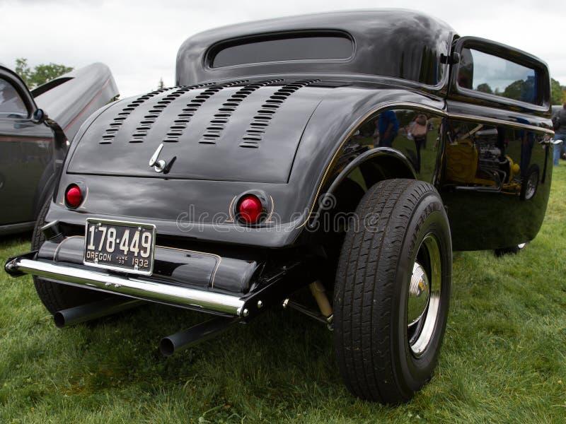乌黑旧车改装的高速马力汽车 免版税图库摄影