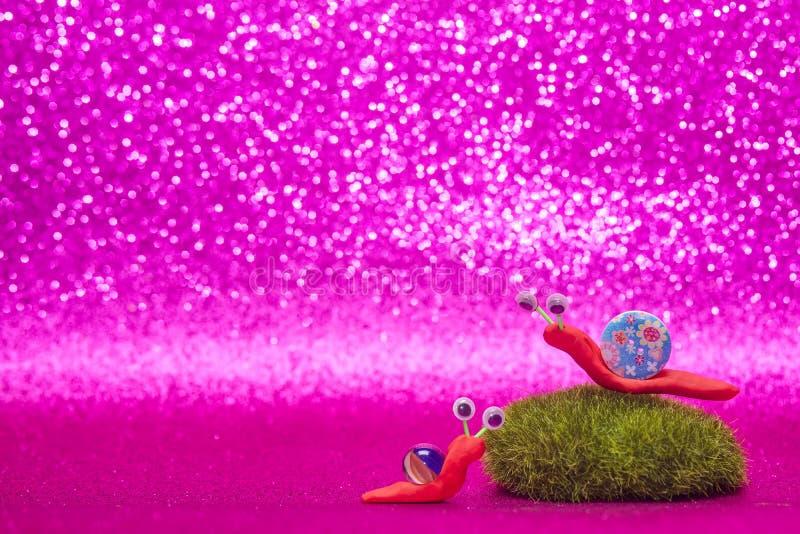乐趣儿童` s背景两蜗牛 免版税库存照片