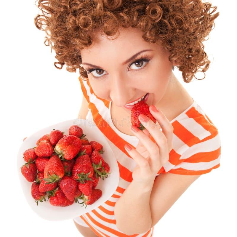 乐趣妇女用草莓 免版税库存图片