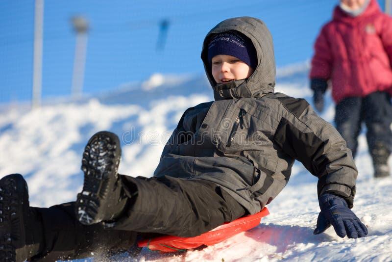 乐趣高sledding的速度 免版税图库摄影