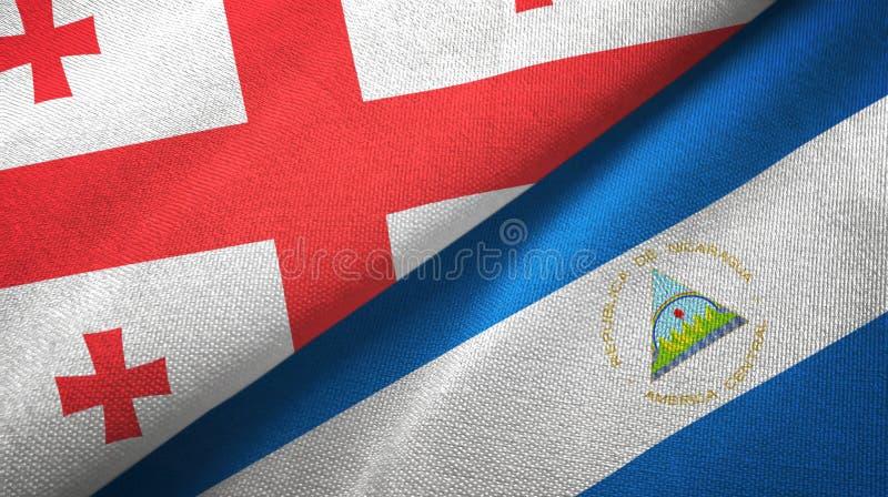 乔治亚和尼加拉瓜两旗子纺织品布料,织品纹理 库存例证