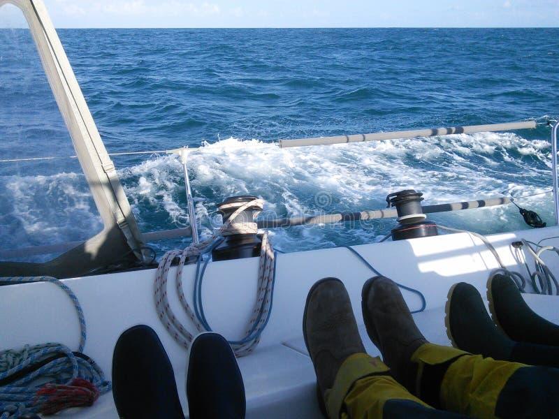 乘员组的脚 免版税库存照片