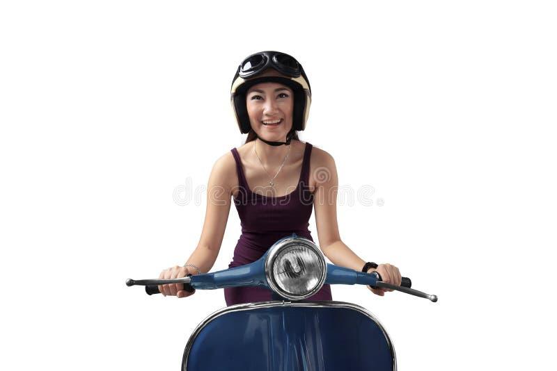 乘坐一辆蓝色滑行车的亚裔妇女 库存图片