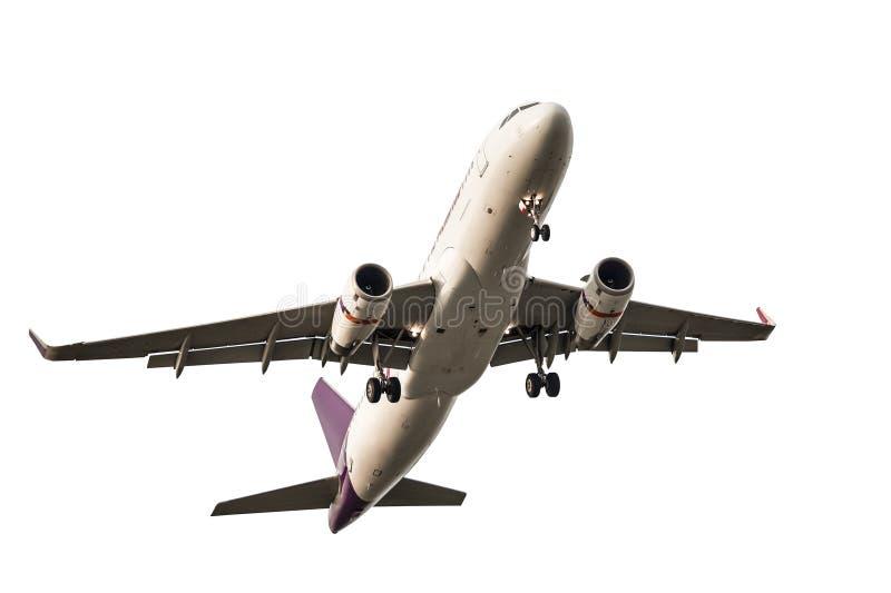 乘客企业飞机离开和在白色backgro的飞行 库存图片