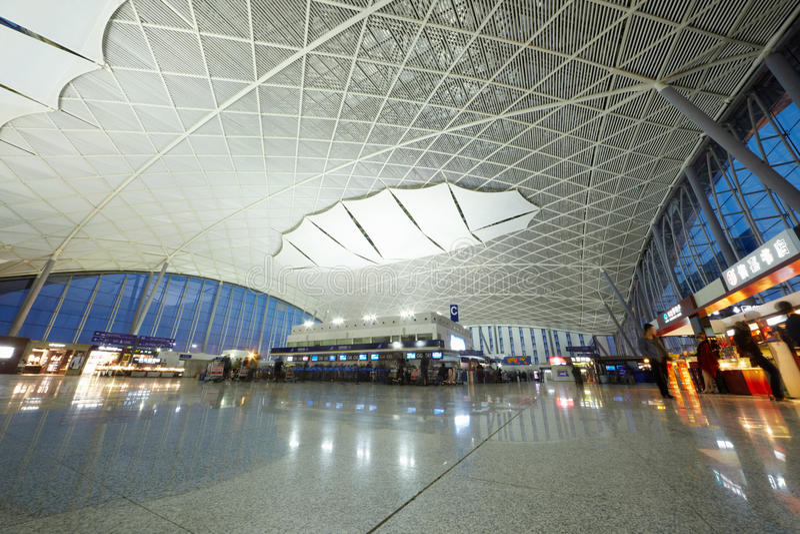 乘客在广州机场(Baiyun) 免版税库存图片
