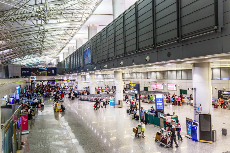 乘客在广州机场(Baiyun) 图库摄影