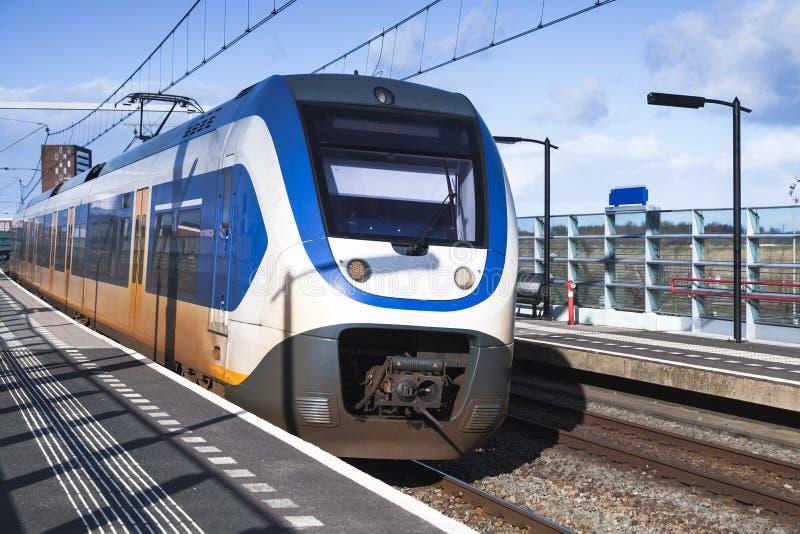 乘客电车在火车站附近去 库存照片