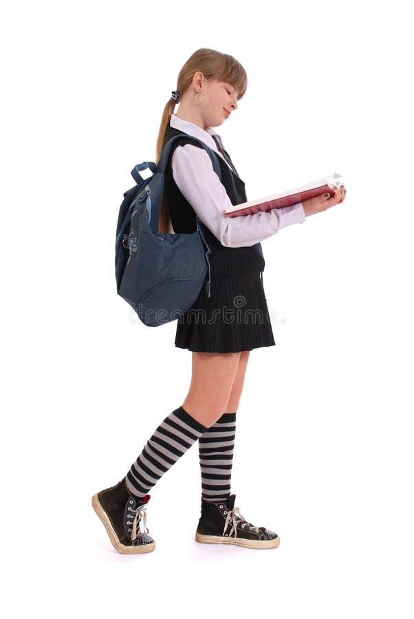 也背景书方向女孩现有量暂挂红色指定白色 免版税图库摄影