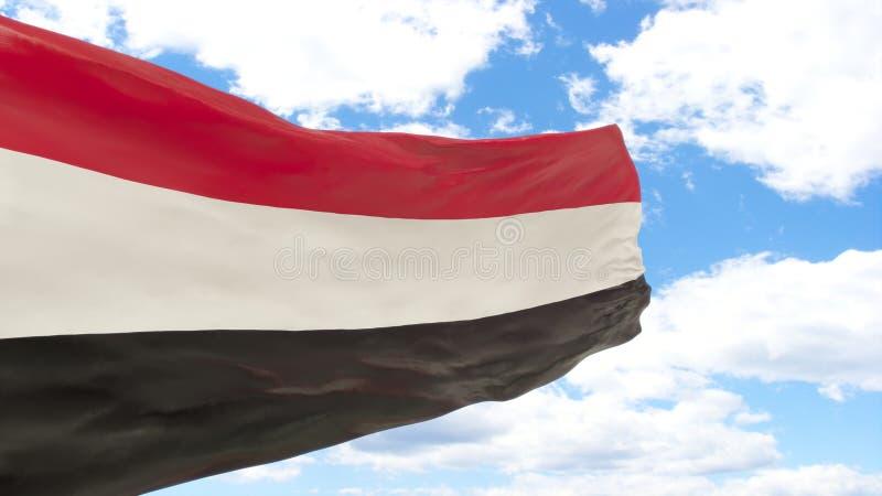 也门的挥动的旗子蓝色多云天空的 免版税库存照片
