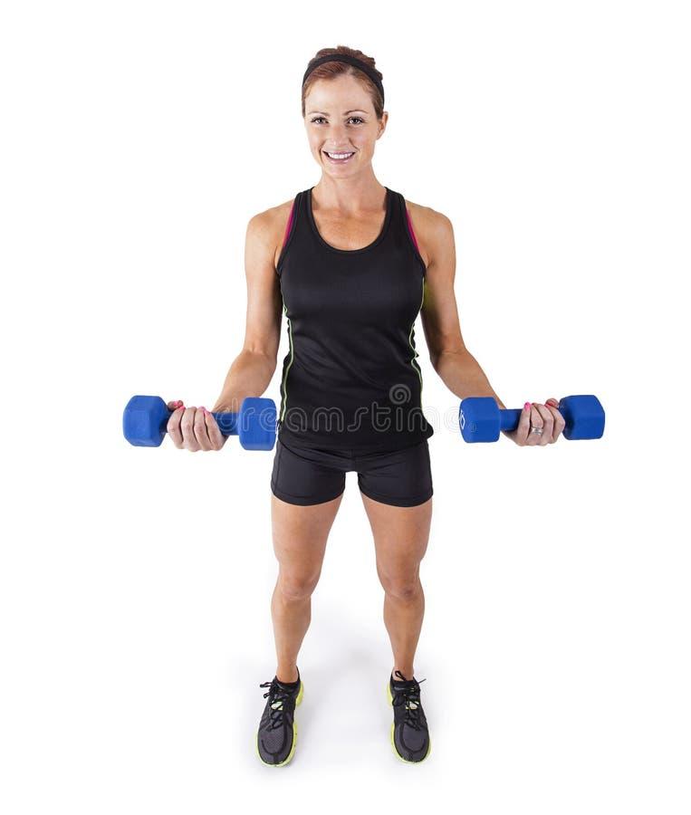 练习在白色背景的健身妇女自由举重 图库摄影