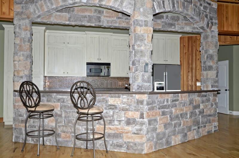 乡村风格住宅的内部厨房区 图库摄影