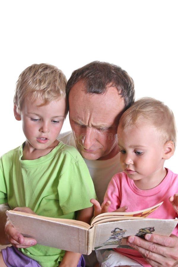 书儿童祖父读 图库摄影