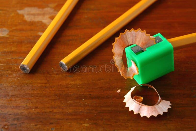 书写在磨削器和两支unsharpened铅笔 图库摄影