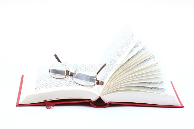 书和玻璃 免版税库存照片