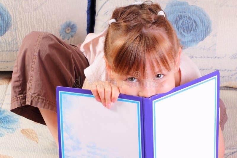 书女孩相当一点 库存照片
