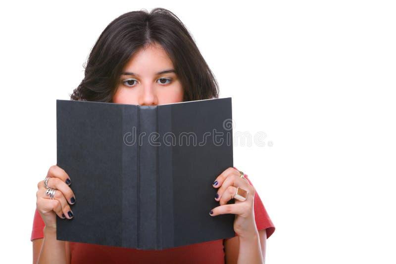 书女性读取少年 免版税库存照片