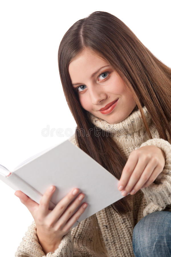 书愉快的高领衫佩带的妇女年轻人 库存照片