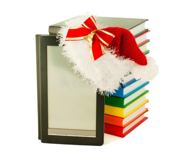 书电子帽子阅读程序s圣诞老人佩带 免版税库存图片