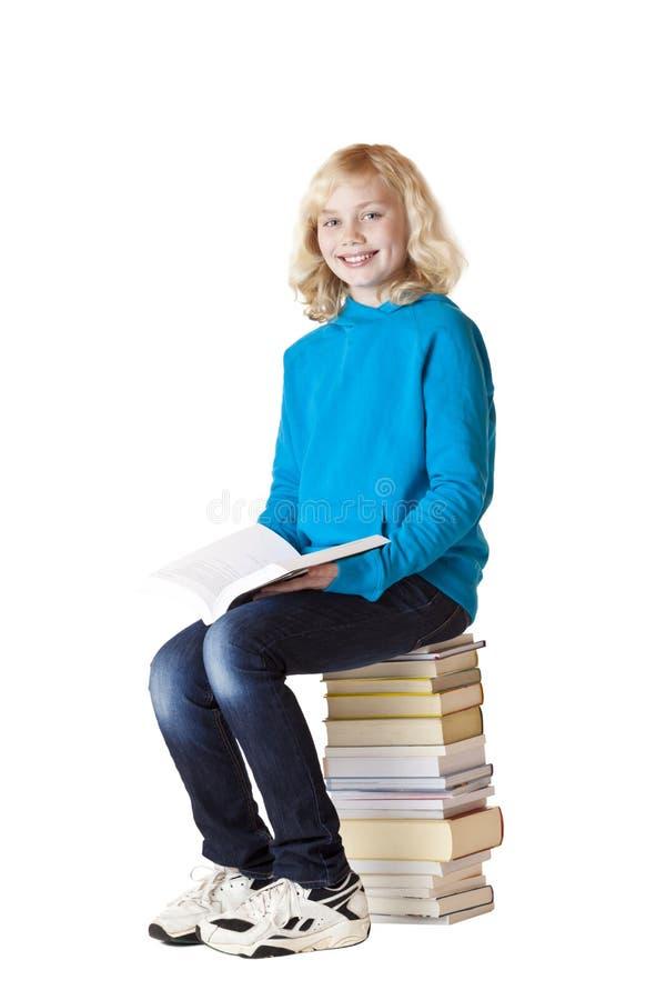 书登记愉快的读取学校女小学生 库存图片