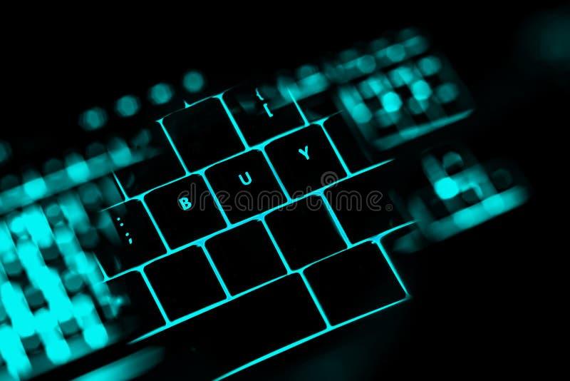 买在键盘的有启发性按钮的文本 免版税库存图片