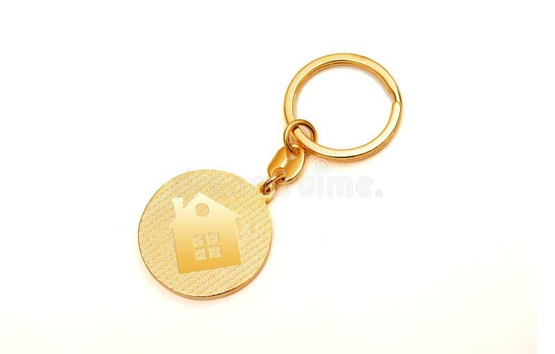 买您的梦之家与家庭象的钥匙圈 免版税库存照片