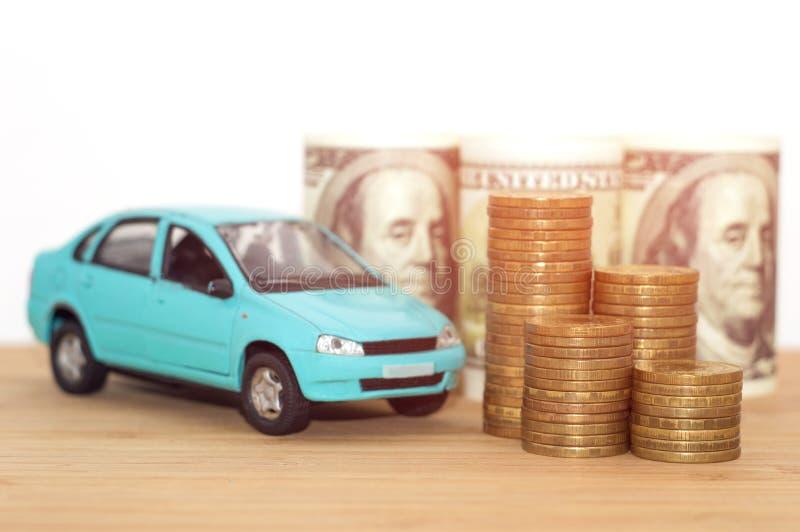 买的汽车美元硬币堆 免版税库存图片