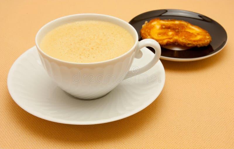 乳白色的咖啡杯 库存照片