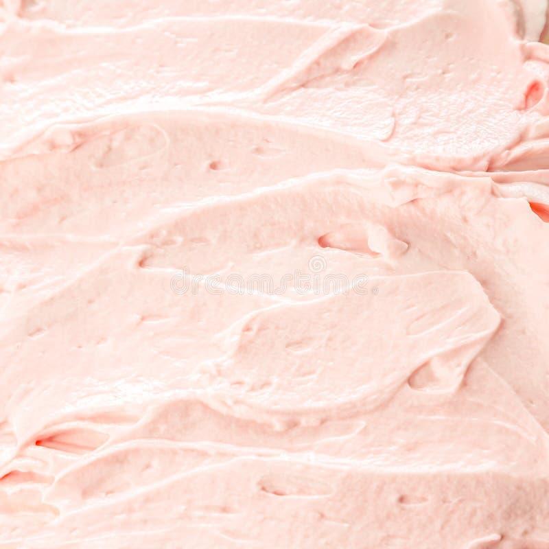 乳脂状的桃红色莓果冰淇凌背景 免版税库存照片