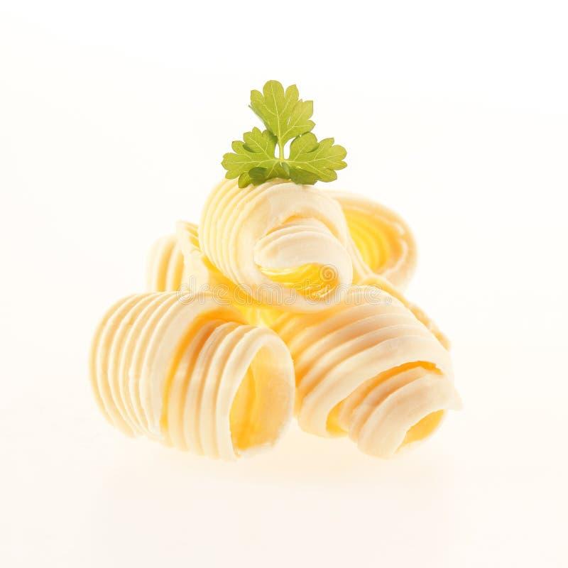 乳脂状的黄油滚动的卷  库存图片