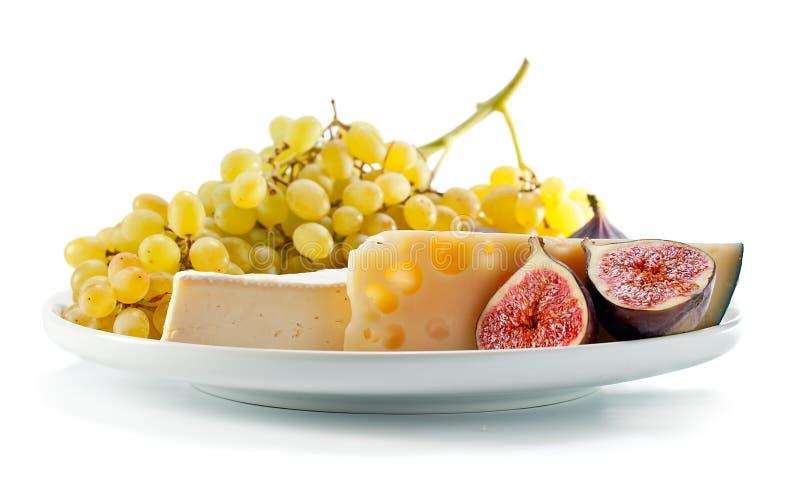 乳酪用在白色隔绝的果子 图库摄影