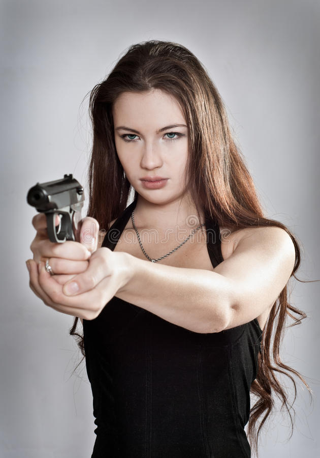 争取女孩枪 库存照片