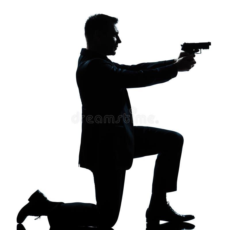 争取枪下跪人剪影 库存图片