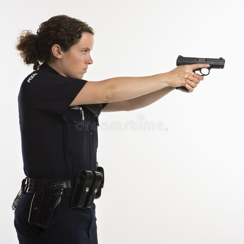 争取枪女警 库存图片