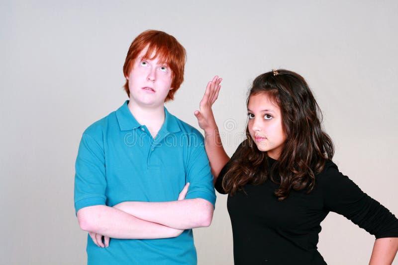 争论青少年男孩的女孩 免版税库存图片