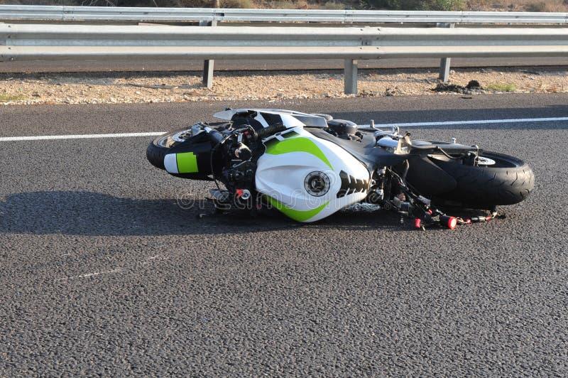 事故自行车摩托车路 库存照片