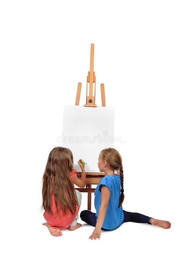 二小女孩绘画 免版税图库摄影
