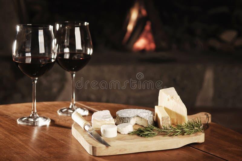 Download 二杯在一个舒适壁炉的红葡萄酒 库存照片. 图片 包括有 干酪, 葡萄酒杯, 巴马干酪, 方便, 山羊, 迷迭香 - 30328036
