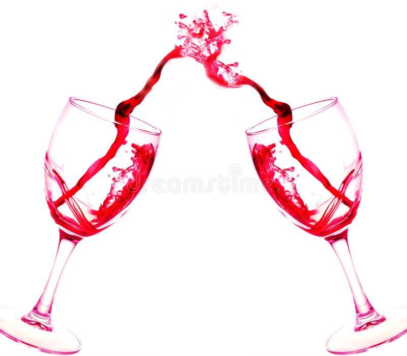 二杯红葡萄酒在白色隔绝的摘要飞溅 免版税图库摄影