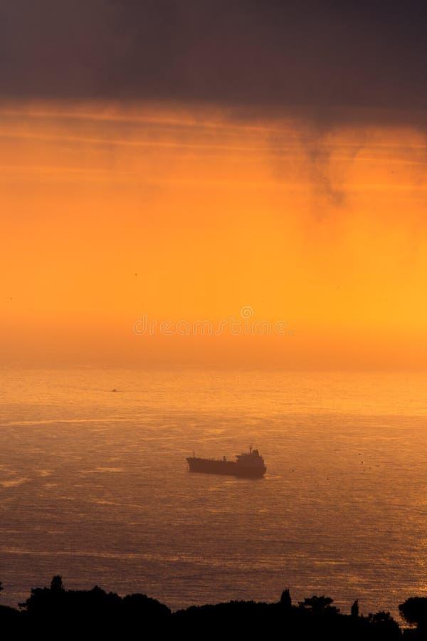 云彩和光在海阿尔及尔海湾的  库存照片