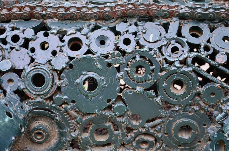互相被焊接和被绘的绿色一套的构成齿轮和汽车零件 难看的东西steampunk textur 图库摄影