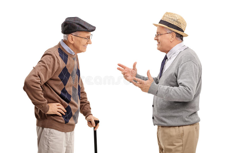 互相谈话两资深的先生们 免版税图库摄影