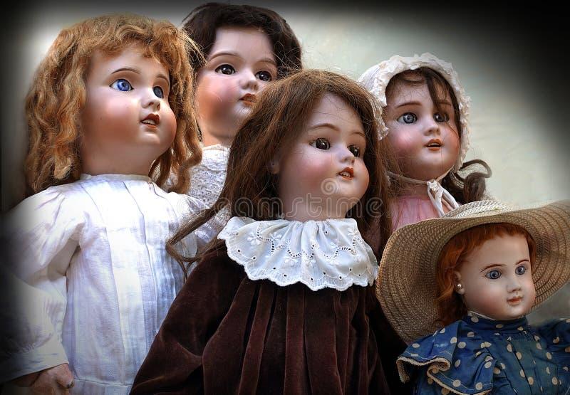 五个古色古香的玩偶 免版税库存照片
