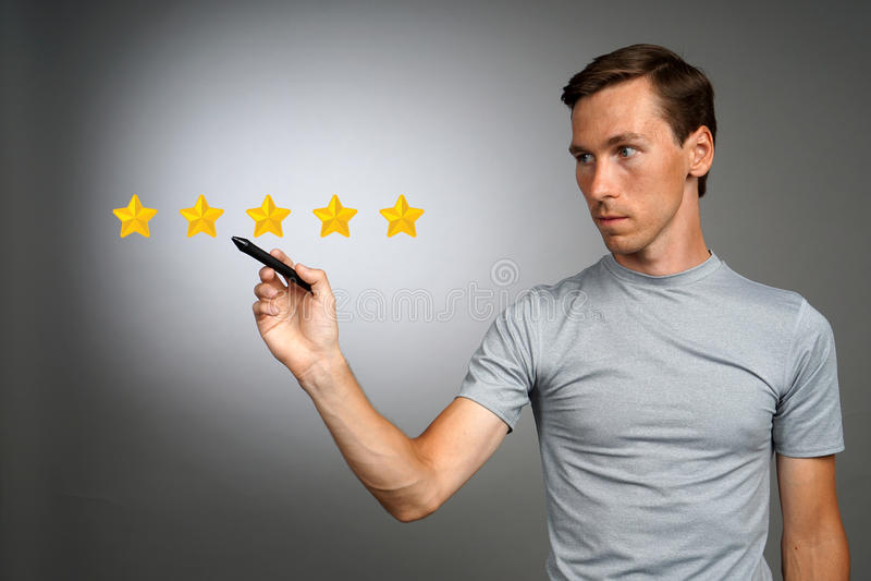 五个星规定值或等级,基准点概念 人估计服务,旅馆,餐馆 库存照片