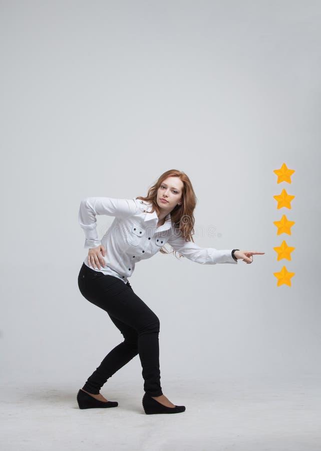 五个星规定值或等级,基准点概念 妇女估计服务,旅馆,餐馆 库存图片