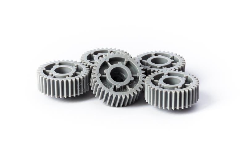 五个灰色塑料齿轮 免版税库存照片